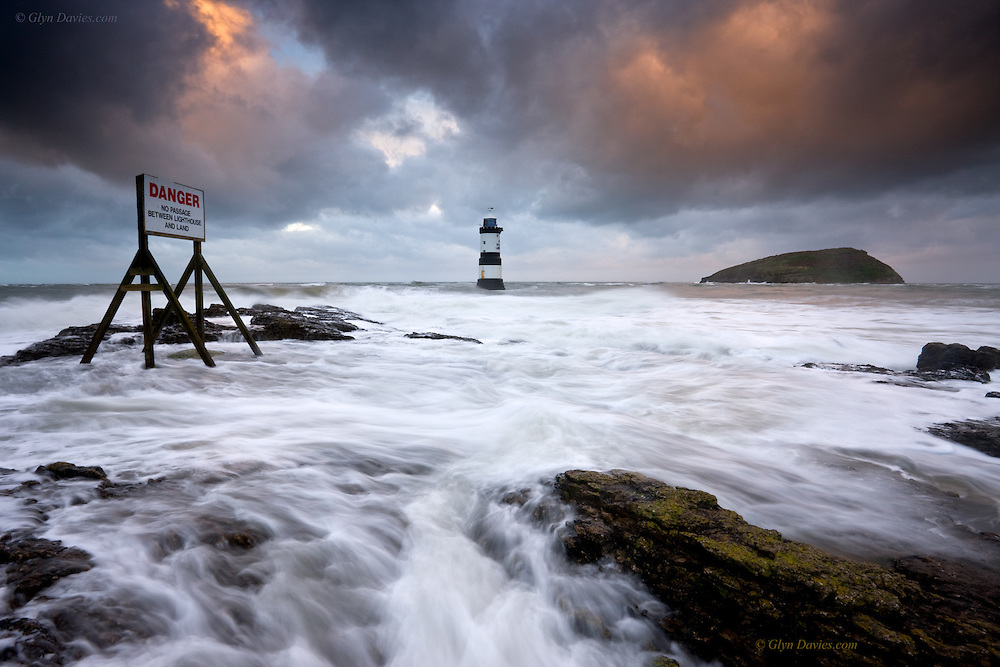 Nominated in 10th (2017) International Colour Awards (Nature category) <br /> <br /> This small sound of water at Penmon can be treacherous as a huge volume of tide pulls around this point at each turn of the tide and there is a relatively shallow rocky chanel beneath. The present Penmon lighthouse at 29m tall was erected between 1835 and 1838. It was converted to solar power in 1996 and it's 15,000 candela light can be seen 12 nautical miles away. It also has a fog bell which sounds every thirty seconds.