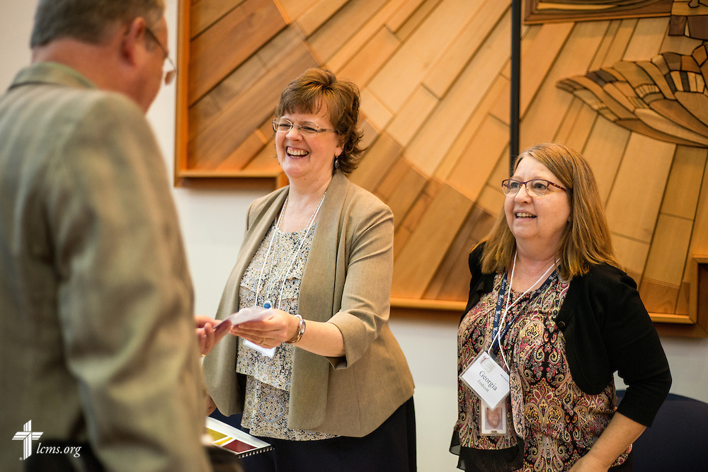 Rachel Asburry and Georgia Endicott welcome members during floor-committee weekend at the International Center of The Lutheran Church–Missouri Synod on Friday, May 27, 2016, in Kirkwood, Mo. LCMS Communications/Erik M. Lunsford