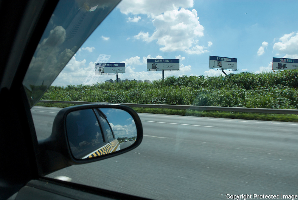 Adverts on a motorway outside Sao Paulo, Brazil.<br />