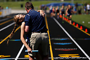 Fowler runner Morgan Goerge collapses into Fowler boys track coach Brett Schafer's arms immediately after crossing the finish line to win the girls 4x400 meter relay at the MHSAA Division 4 Boys and Girls Track and Field State Finals in Grand Rapids, Mich., on Saturday, June 2, 2018. After the 4x400, the final race of the day, the Fowler girls track team claimed the 2018 state title. Goerge later said that she started passing out after runs during this season of track and now goes down about three times a day. Goerge added that her doctor says he has seen multiple cases like hers over the past ten years and Goerge says that while it is not common, it doesn't seem to affect her health in any noticable way.