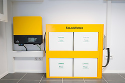 Electric batteries to store energy from solar panels in modern highly energy efficient family house  in Germany