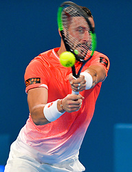 Damir Dzumhur of Bosnia  returns the ball to Novak Djokovic of Serbia during their first round of ATP Qatar Open Tennis match at the Khalifa International Tennis Complex in Doha, capital of Qatar, on January 01, 2019. Djokovic  won 2-0  (Credit Image: © Nikku/Xinhua via ZUMA Wire)
