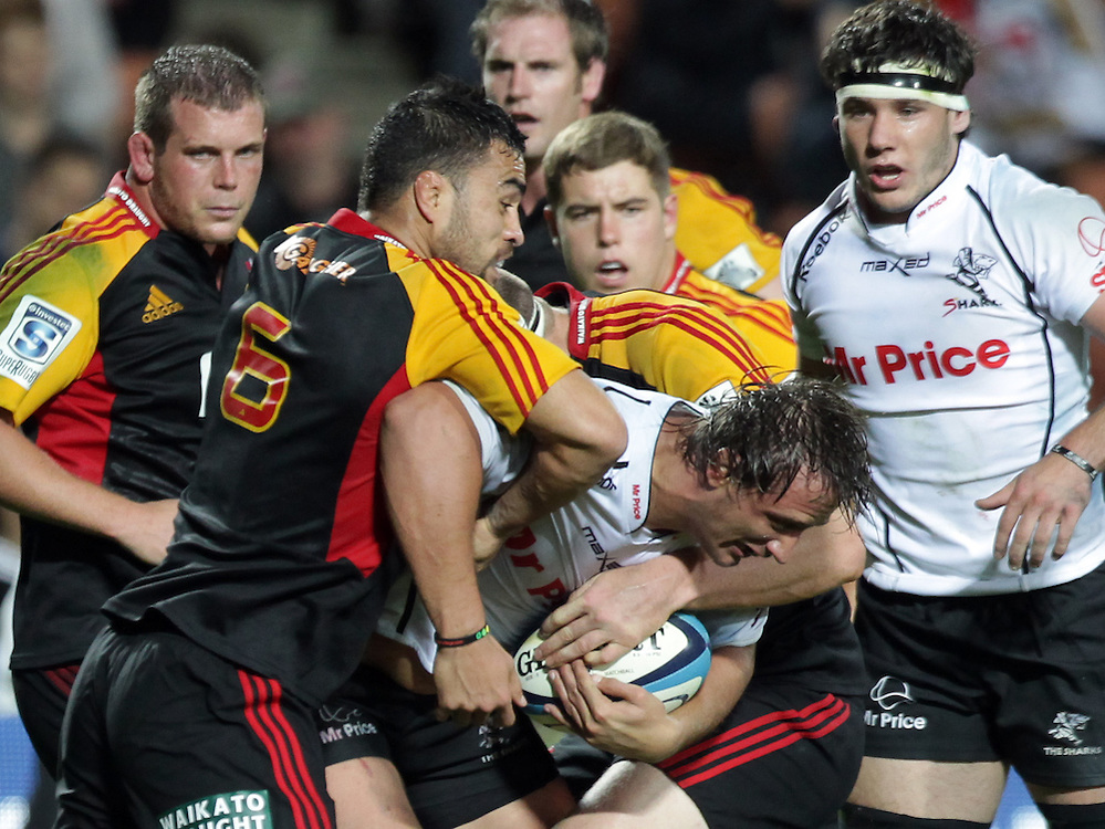 Sharks' Anton Bresler is tackled by Chiefs' Liam Messam in a Super Rugby match, Waikato Stadium, Hamilton, New Zealand, Saturday, April 27, 2013.  Credit:SNPA / David Rowland