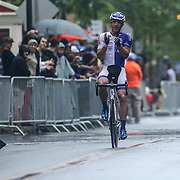 Brad White of team United Health care Pro cycling  celebrates as he crosses the Finish line in front of the Grand Opera House on Market Street to win the Men's Pro & Category I (35 miles) race for the third consecutive time in three years Saturday, May 14, 2016, in Wilmington Delaware.
