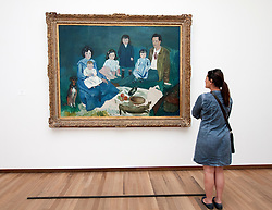 Woman looking at painting La Famille Soler by Pablo Picasso at Bonnefanten Museum in Maastricht , Limburg , The Netherlands