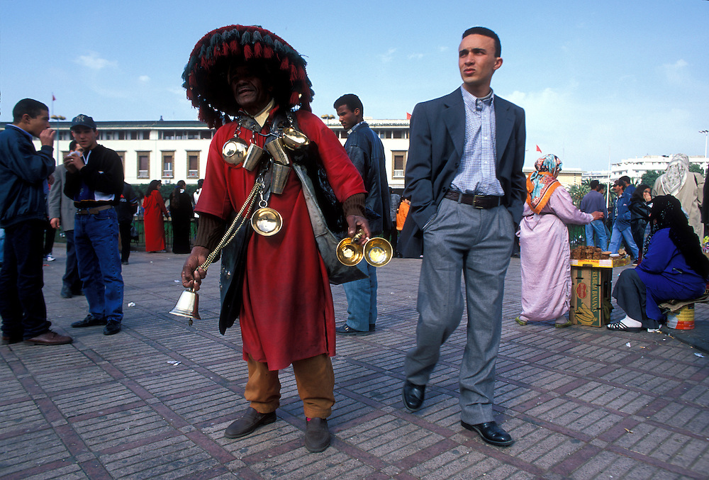 Africa, Morocco, Water seller in ornate traditional dress in Place Mohammed V in central Casablanca