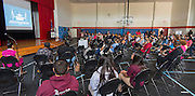 Atendees watch an explainer video on Recapture during a stop of the Listen & Learn tour at Marshall Elementary School, September 20, 2016.