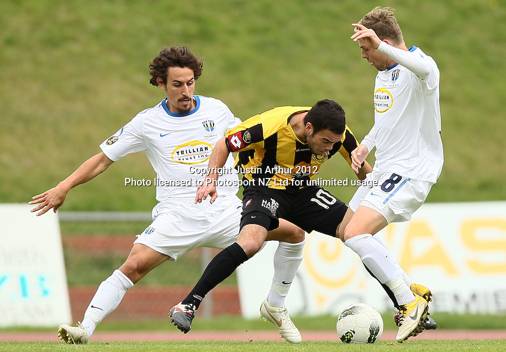 Wellington's Dakota Lucas is put under pressure by Auckland's Albert Riera and David Mulligan.ASB Premiership Football Semifinal - Team Wellington v Auckland City at Newtown Park, Wellington, New Zealand on Sunday 15 April 2012. Photo: Justin Arthur / Photosport.co.nz