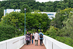 People of footbridge on campus at Stirling University in Scotland , united Kingdom