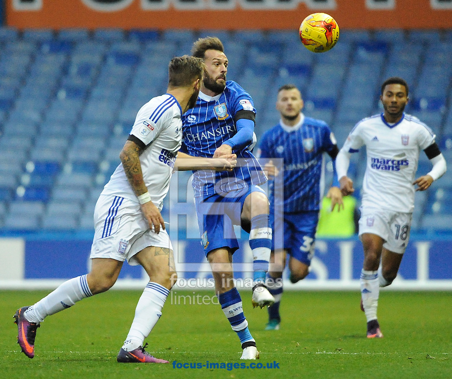 Steven Fletcher of Sheffield Wednesday and Luke Chambers (L) of Ipswich Town battle for the ball during the Sky Bet Championship match at Hillsborough, Sheffield<br /> Picture by Richard Land/Focus Images Ltd +44 7713 507003<br /> 05/11/2016