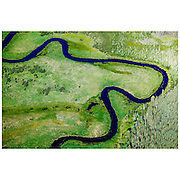 A river in the boreal forest near Fort McMurray in Alberta, Canada. The Athabasca oil sands deposit is among the largest in the world, and huge surface mine operations dominate the landscape. The bitumen, also commonly named tar, contains lots of hydrocarbons, but is notoriously hard to extract. For every 100 BTU of energy extracted, 70 BTU is lost in the process. In 2011 alone, the oil sands operations in Canada produced 55 million tons of 'greenhouse gas emissions'. That's eight percent of Canada's total emissions.