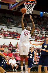 November 1, 2009; Stanford, CA, USA;  Stanford Cardinal forward Nnemkadi Ogwumike (30) shoots past Vanguard Lions forward Miljana Cejic (31) during the first half at Maples Pavilion.