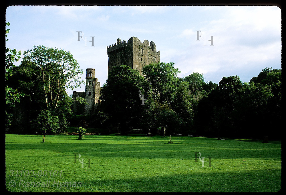 Blarney Castle (c. 1446), one of Ireland's oldest, nestles amid trees on 400-ac estate; Blarney. Ireland