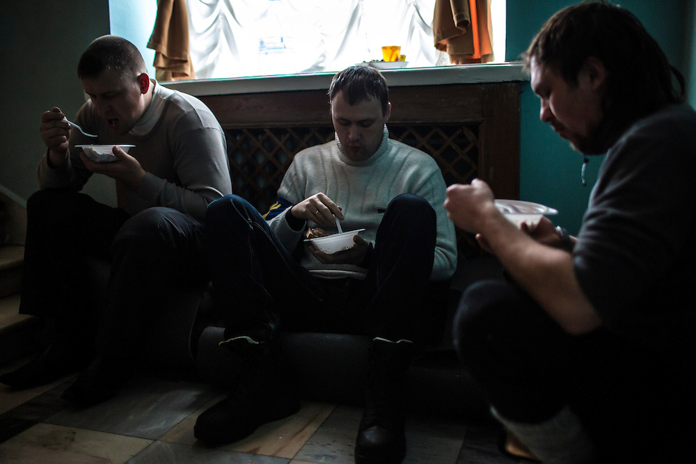 KIEV, UKRAINE - DECEMBER 8: Anti-government protesters eat breakfast inside the occupied International Centre of Culture and Arts, one of several buildings occupied as a base of operations for protesters, on December 8, 2013 in Kiev, Ukraine. (Photo by Brendan Hoffman/Getty Images)