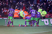 Bristol City players mob Bristol City forward Andreas Weimann (14) after he puts city 2-3 up during the EFL Sky Bet Championship match between Sheffield United and Bristol City at Bramall Lane, Sheffield, England on 30 March 2019.