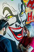 Opera Gallery London presents a selection of canvas works by the world renowned 'Godfather of Graffiti'- Seen (pictured with the Joker). The exhibition takes inspiration from the growing American comic book cultural phenomenon, paying homage to some of the world's most iconic crime fighters and villains; including Batman, Wonder Woman, Superman and includes his 'dazzling' depiction of Captain America. Opera Gallery, New Bond Street, London.