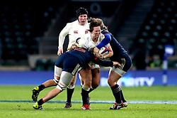 Marlie Packer of England is tackled by two France players - Mandatory by-line: Robbie Stephenson/JMP - 04/02/2017 - RUGBY - Twickenham - London, England - England v France - Women's Six Nations
