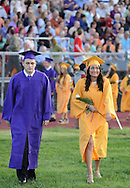 UPPER MORELAND, PA - JUNE 05: Eric Portone (L) and Danielle Perrelli walk into Upper Moreland High School's 2014 graduation ceremony.June 5, 2014 in Upper Moreland, Pennsylvania. (Photo by William Thomas Cain/Cain Images)