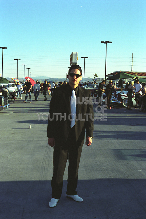 Man in a sharp suit wearing shades and white patent shoes, Las Vegas, USA, 2000's