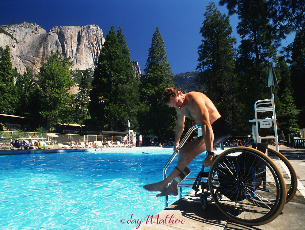 Mark Wellman transitions from his wheelchair to the Yosemite Lodge pool where he was training for a climb on Half  Dome.  August 24, 1991