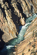 The Yellowstone River flows through the Grand Canyon of the Yellowstone downstream from Yellowstone Falls in Yellowstone National Park, in Wyoming, USA. Yellowstone River is a major tributary of the Missouri River. Yellowstone was the first national park in the world (1872), and UNESCO honored it as a World Heritage site in 1978.