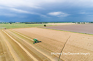 63801-14314 Aerial view of combine harvesting wheat ahead of a thunderstorm Marion Co. IL