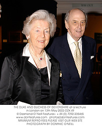 THE DUKE AND DUCHESS OF DEVONSHIRE at a lectrure in London on 13th May 2002.OZX 49