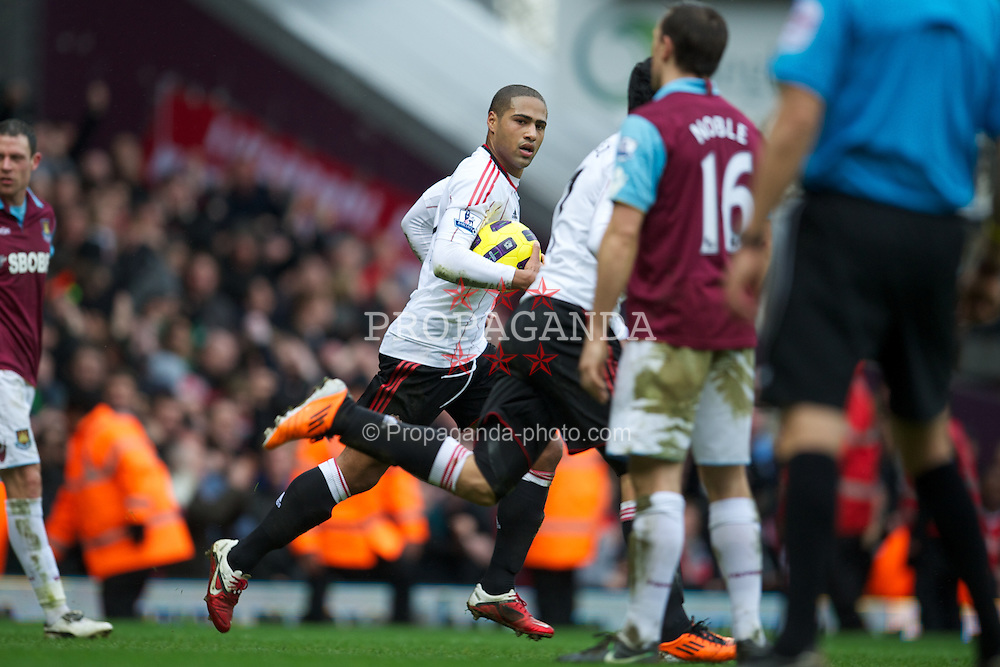 LONDON, ENGLAND - Sunday, February 27, 2011: Liverpool's Glen Johnson celebrates scoring his side's only goal in a 3-1 defeat to West Ham United during the Premiership match at Upton Park. (Photo by David Rawcliffe/Propaganda)