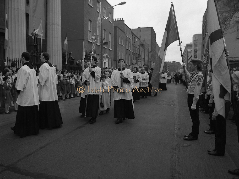 Episcopal Ordination Of Desmond Connell. (R74).1988..06.03.1988..03.06.1988..6th March 1988..Following the death of Archbishop Kevin McNamara in April '87, Pope John Paul II surprisingly nominated Desmond Connell for the position of Archbishop of Dublin. The ordination of Dr Connell took place at the Pro-Cathedral in Dublin...Picture shows the procession down Marlborough Street, Dublin a prelude to the Episcopal Ordination of Dr Desmond Connell.Girl guides and scouts formed the guard of honour.