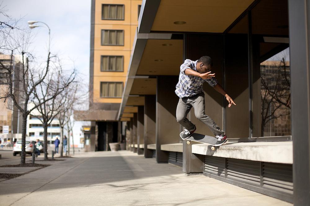 ANCHORAGE, AK - APRIL 2012: Skateboarder Preston Pollard in downtown Anchorge, Alaska.