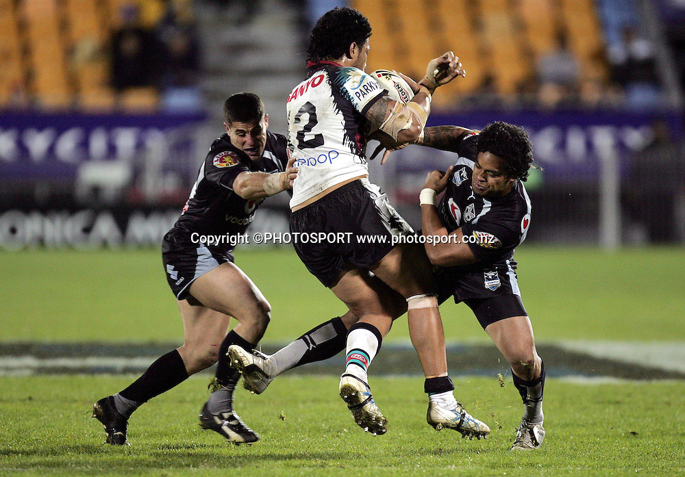 Penrith's Tony Puletua is tackled by Warriors' Epalahame Lauaki (R) and George Gatis (L) during the NRL rugby league match between the Vodafone Warriors and the Penrith Panthers at Mt Smart Stadium, Auckland on Friday 22 June 2007. Photo: Hagen Hopkins/PHOTOSPORT **NO COMMERCIAL USE**