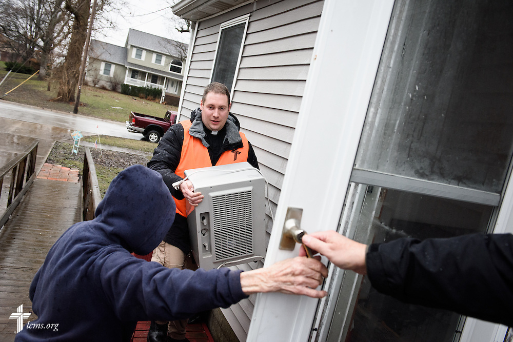 The Rev. Michael Meyer, manager of LCMS Disaster Response, carries a dehumidifier to a flooded basement during a volunteer cleanup event on Saturday, Jan. 9, 2016, in Watseka. Ill.  LCMS Communications/Erik M. Lunsford