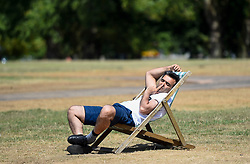 © Licensed to London News Pictures. 01/08/2018. LONDON, UK.  A man sunbathes during warm weather in Hyde Park.  Temperatures are forecast to increase back to the 30s in time for the weekend  Photo credit: Stephen Chung/LNP