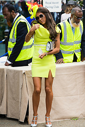 Ascot, UK. 20 June, 2019. A racegoer in a fluorescent dress attends Ladies Day at Royal Ascot.