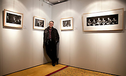 © Licensed to London News Pictures. LONDON, UK  10/06/11. Photographer Mike Mitchell stands next to prints of his unseen Beatles pictures to be auctioned by Christies in London on 20th July 2011. Taken when Mr Mitchell was just 18 during the Beatles historic 1964 visits to America the images have been filed away for nearly 50 years. Please see special instructions for usage rates. Photo credit should read Matt Cetti-Roberts/LNP