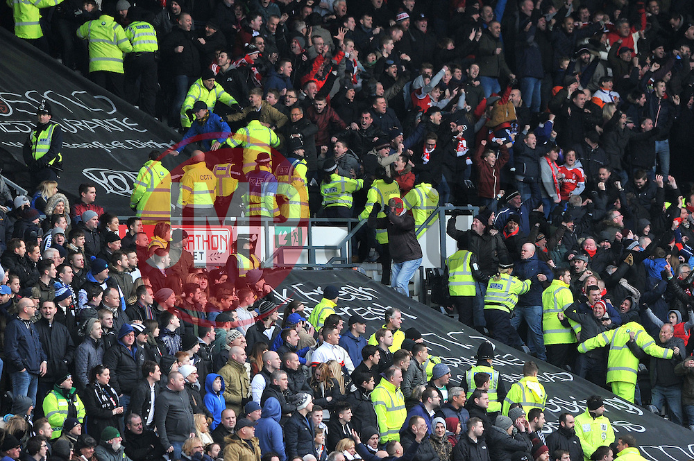 Nottingham Forest fans celebrate in front of the Derby County fans - Photo mandatory by-line: Dougie Allward/JMP - Mobile: 07966 386802 - 17/01/2015 - SPORT - Football - Derby - iPro Stadium - Derby County v Nottingham Forest - Sky Bet Championship