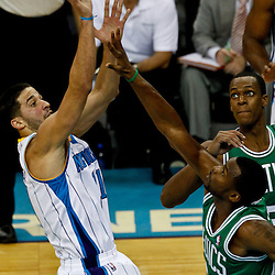 December 28, 2011; New Orleans, LA, USA; New Orleans Hornets guard Greivis Vasquez (21) shoots over Boston Celtics guard Keyon Dooling (51) during the fourth quarter of a game at the New Orleans Arena. The Hornets defeated the Celtics 97-78.  Mandatory Credit: Derick E. Hingle-US PRESSWIRE
