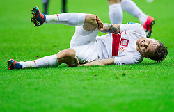 Artur Sobiech of Poland injured during the UEFA EURO 2012 group A match between Poland and Russia at The National Stadium on June 12, 2012 in Warsaw, Poland.  (Photo by Vid Ponikvar / Sportida.com)