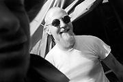 Man with round sunglasses and Goatee beard. Ashton Court Festival. Bristol 1995.