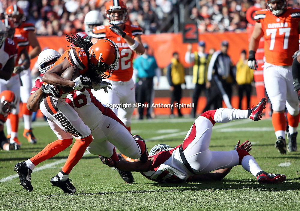 Cleveland Browns wide receiver Travis Benjamin (11) catches a second quarter pass for a first down at the Arizona Cardinals 18 yard line while covered by Arizona Cardinals cornerback Patrick Peterson (21) and tackled by Arizona Cardinals outside linebacker LaMarr Woodley (56) during the 2015 week 8 regular season NFL football game against the Arizona Cardinals on Sunday, Nov. 1, 2015 in Cleveland. The Cardinals won the game 34-20. (©Paul Anthony Spinelli)