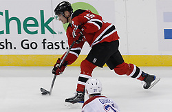 Jan 22, 2010; Newark, NJ, USA; New Jersey Devils right wing Jamie Langenbrunner (15) takes a shot during the first period at the Prudential Center.