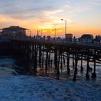 he Santa Monica Pier amid the sunset on Tuesday, February 16, 2010.