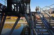 Galerie de la Villette, a raised pedestrian walkway crossing the Parc de la Villette, crossing over the Canal de l'Ourcq, in the 19th arrondissement of Paris, France. The Canal de l'Ourcq is a 108.1km waterway begun in 1802 between Port-aux-Perches and the Canal Saint-Martin via the Bassin de la Villette or La Villette Basin. Picture by Manuel Cohen
