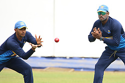 July 6, 2018 - Sri Lanka - Sri Lanken cricketer Dhananjaya de Silva (L) catches the ball during a practice session at the R.Premadasa Stadium in Colombo on July 6, 2018. - South Africa will play two Tests, five 50-over One-Day Internationals (ODIs), and one T20 in Sri Lanka between July 12 and August 14. The first Test between South African and Sri Lanka will be played on July 12 at the Galle International Cricket Stadium in Galle. (Credit Image: © Lahiru Harshana/Pacific Press via ZUMA Wire)