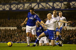 Liverpool, England - Wednesday, December 5, 2007: Everton's Tim Cahill and Zenit St. Petersburg's Erik Hagen during the UEFA Cup Group A match at Goodison Park. (Photo by David Rawcliffe/Propaganda)