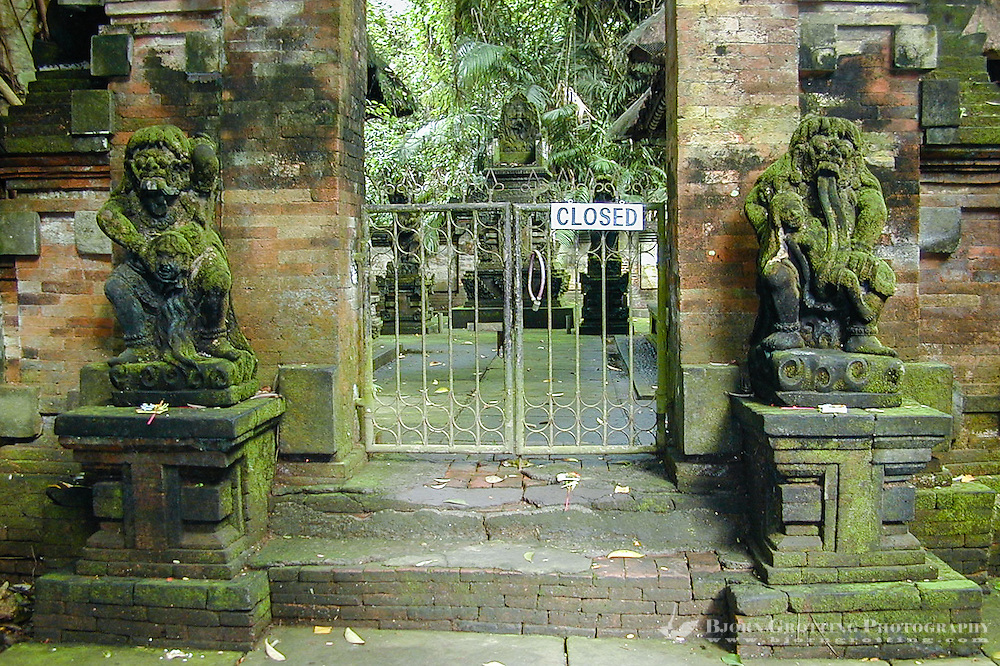 Bali, Gianyar, Ubud. Two statues of Rangda guards the entrance to the inner temple of Pura Prajapati. Rangda is  the witch who is feasting on small children, an important mythical figure on Bali.