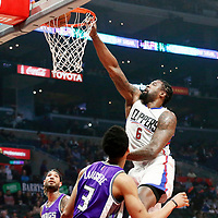 26 March 2016: LA Clippers center DeAndre Jordan (6) goes for the dunk over Sacramento Kings forward Skal Labissiere (3) during the Sacramento Kings 98-97 victory over the Los Angeles Clippers, at the Staples Center, Los Angeles, California, USA.