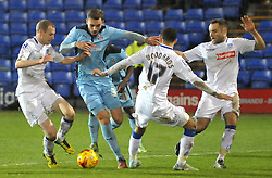 Greg Taylor of Cambridge United is challenged by Marc Laird (L) and Danny Woodards of Tranmere Rovers - Photo mandatory by-line: Richard Martin-Roberts - Mobile: 07966 386802 - 19/12/2014 - SPORT - Football - Birkenhead - Prenton Park - Tranmere Rovers v Cambridge United - Sky Bet League Two