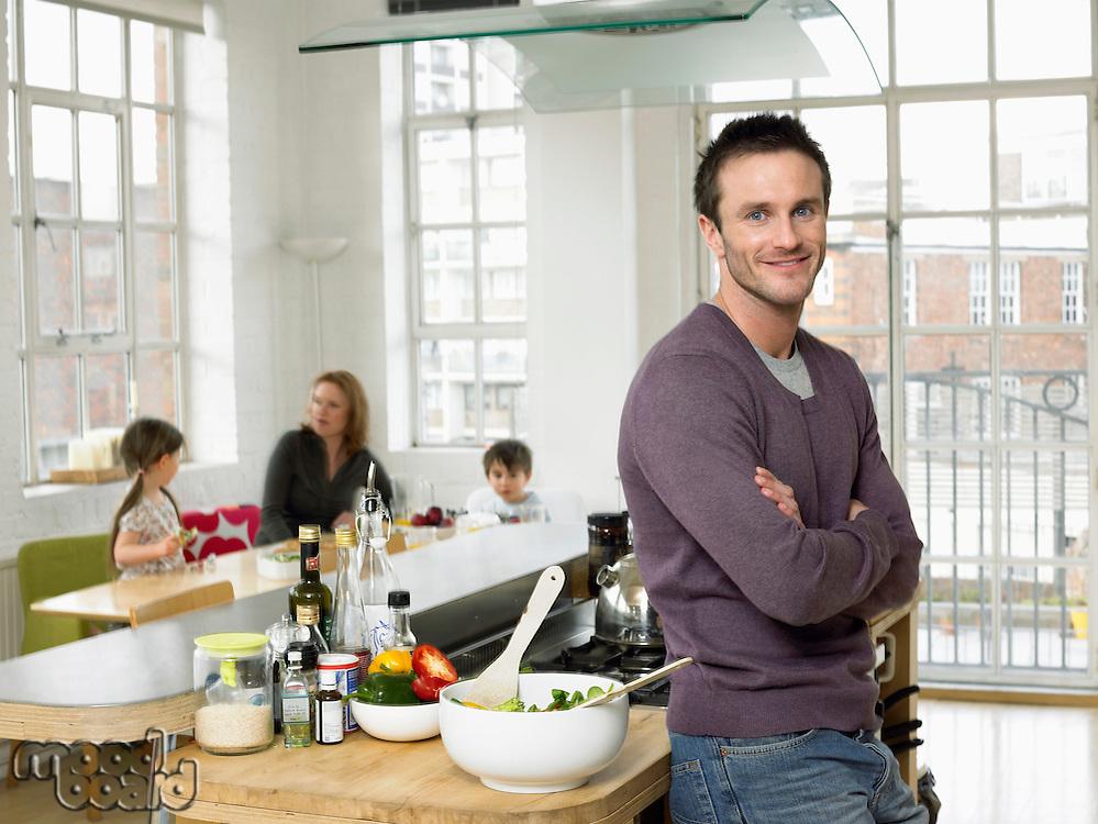 Man standing in kitchen smiling (portrait)