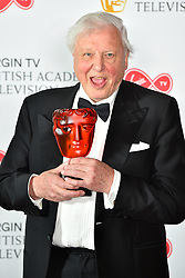 Sir David Attenborough with his BAFTA Award at the Virgin TV British Academy Television Awards 2018 held at the Royal Festival Hall, Southbank Centre, London.